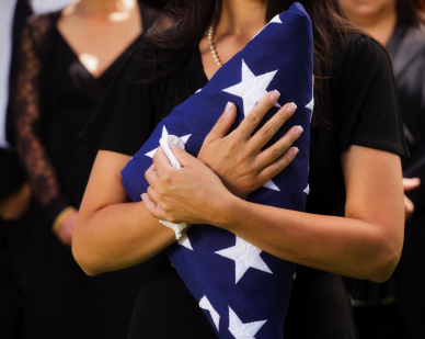 woman with veteran's flag